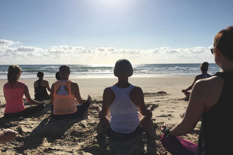 Meditating yoga Sunshine Coast 900x600